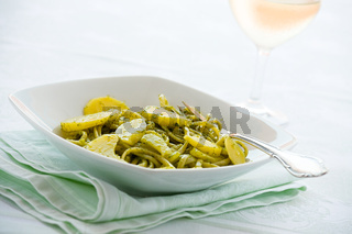 Linguine pasta with pesto genovese and potatoes