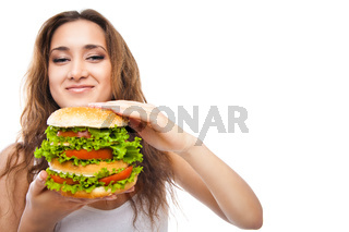 Happy Young Woman Eating big yummy Burger isolated