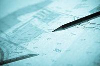 blue backlit surveyor's plan, pencil and set squar