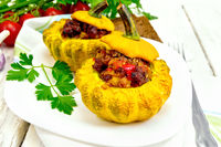 Squash yellow stuffed in white plate on board