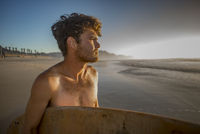 Portrait of a Young Surfer on the Beach