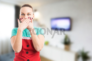 Maid or housekeeper covering her mouth as keeping a secret concept