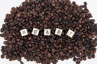 ROAST white cube text on white background AND coffee beans background