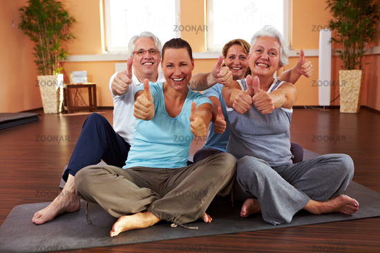 Happy people relaxing in the gym