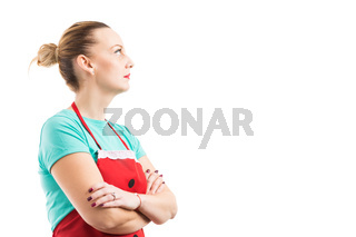 Cleaning lady or housekeeper wearing red apron and looking up