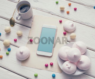 Mock-up of smartphone among colour sweets