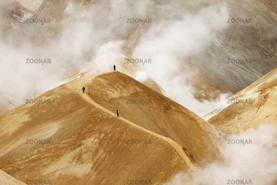 wanderer in the geothermal area with Rhyolith mountains, Hveradalir, Kerlingarfjoell, Iceland