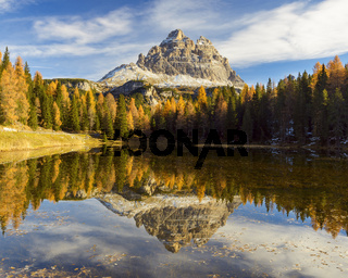 Antorno lake towards Tre Cime di Lavaredo mountain reflected in lake