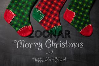 Christmas stocking on a blackboard background, xmas card