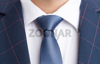 Blue necktie and checkered elegant suit