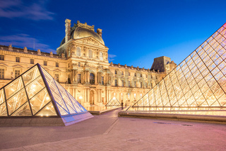 Night view of Louvre Museum in Paris, France