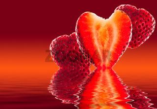 Fresh sliced strawberry in heart shape reflected