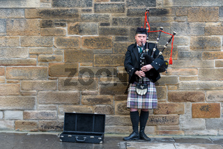 Man playing bagpipes in Edinburgh