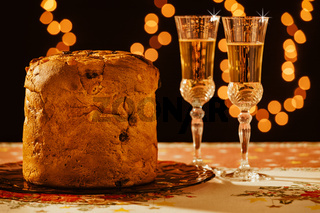 Italian panettone and sparkling wine over a table