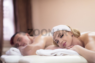 young couple lying on massage table