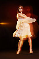 Beautiful young female wearing dress, dancing, multiple exposure non photoshoped montage.