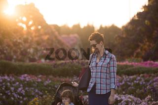 mother and daughter in flower garden