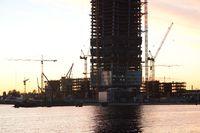Silhouette of under construction skyscraper.