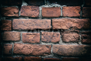 Fragment of old brick wall with multicolored bricks and tones, background