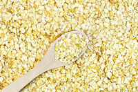 Pea flakes texture with wooden spoon