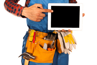 Manual worker man isolated on white with tablet