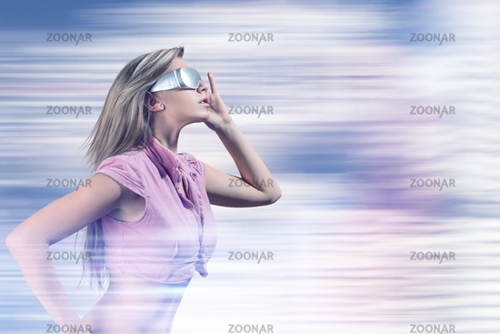 Young woman with futuristic virtual reality glasses