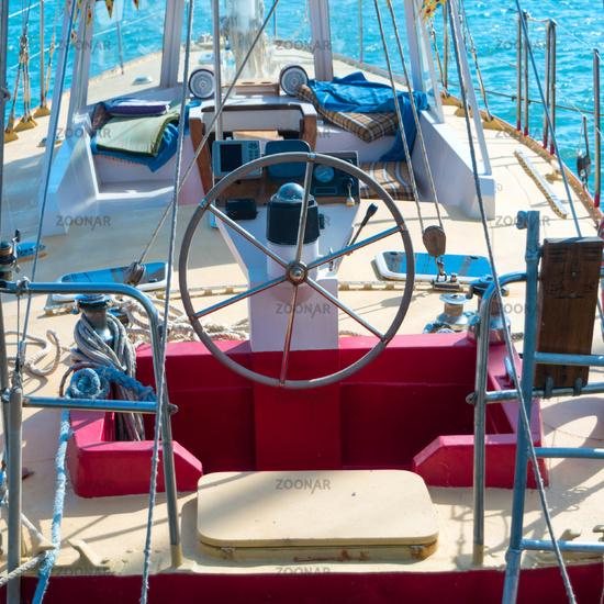 Steering wheel on the yacht