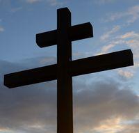 Orthodox cross on blue sky.