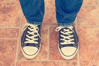 Human legs in sneakers