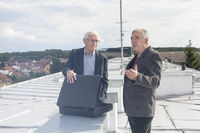 Senior businessmen discussing business deal on the roof of a building