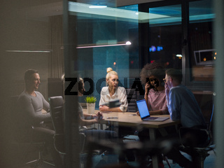 Multiethnic startup business team in night office