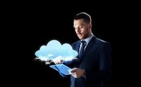 businessman with tablet pc and cloud hologram