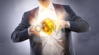 Businessman showing a burning heart