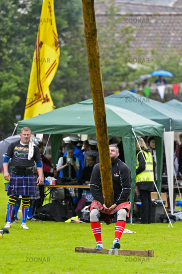 Participant in the caber tossing competition, Ceres Highland Games, Ceres, Scotland, United Kingdom