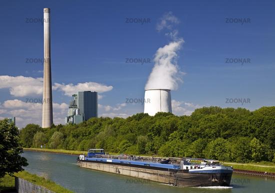 cargo ship on Dattel Hamm Canal in front of Bergkamen power station, Bergkamen, Germany