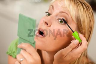 Blonde Woman Applying Her Mascara