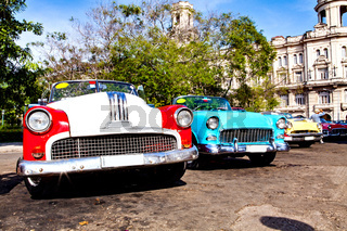 Havana, Cuba, December 12, 2016: Group of colorful vintage classic cars parked in Old Havana