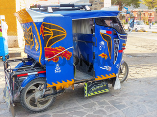 Auto rickshaw parked in the street of Chivay town, Peru
