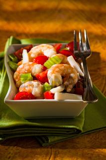 Shrimp salad over a green napkin