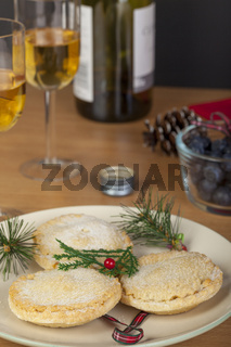 Fresh mince pies and a glass of wine at christmas