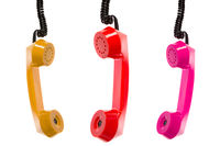 Three colored telephone receivers