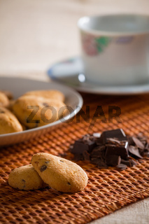 Cookies with chocolate chips on a tablecloth