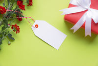 Message card with gift and flowers