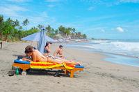 Couple on tropical beach. Bali