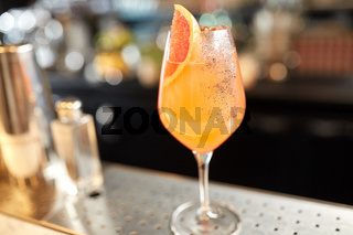 glass of grapefruit cocktail at bar