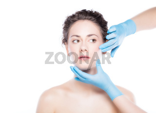 Young beautiful woman's skin review before treatment.