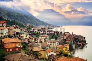 View of Como Lake, Milan, Italy, on sunset with Alps mountains in background