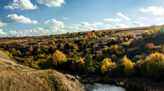 Terrific view of the River Canyon on a sunny fall dayTerrific view of the River Canyon on a cloudy fall day. Buky Canyon on the Hirs'kyi Tikych river in Ukraine.