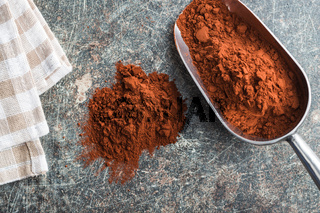 Tasty cocoa powder in scoop.