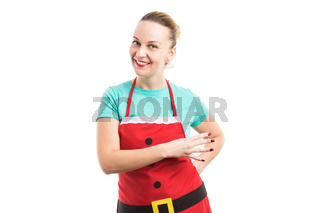 Housewife wearing red Christmas apron showing number four